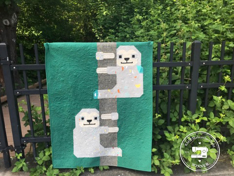 Sloth quilt with logo